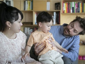 Vi Nguyen and Simon Ducharme with their 2 1/2-year-old son, Lionel Ducharme. at home on Thursday June 17, 2021.