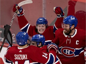 Canadiens'  Cole Caufield, centre, celebrates with teammates Nick Suzuki, Brendan Gallagher and Shea Weber, right, after beating the Vegas Golden Knights in Game 6 to advance to the Stanley Cup final.