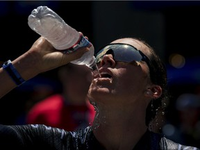 Triathlete Jackie Hering stays hydrated at an event in June in Des Moines, Iowa. Drinking cold water or a slurry of ice and water can help with the mental challenge of working out in the heat, Jill Barker writes, but be careful to avoid a brain freeze or upset stomach.