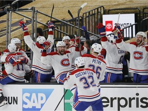 The Canadiens celebrate a goal by Cole Caufield (not pictured) against the Vegas Golden Knights during the second period in Game 5 at T-Mobile Arena in Las Vegas on June 22, 2021.