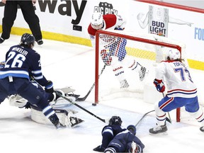 Montreal Canadiens centre Nick Suzuki  scores on Winnipeg Jets goaltender Connor Hellebuyck in the first period of Game 1 at Bell MTS Place in Winnipeg on June 2, 2021.