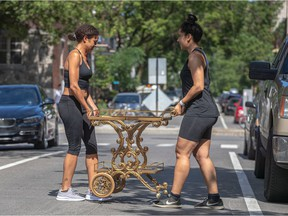 Sisters Caroline and Beatrice Gravel, right, were moving from the Plateau to Hochelaga-Maisonneuve yesterday during the annual moving day bonanza in the city.
