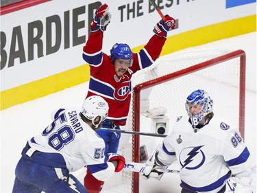 Canadiens' Brendan Gallagher celebrates linemate Phillip Danault's goal past Tampa Bay Lightning goalie Andrei Vasilevskiy and defenceman David Savard during the first period of Game 3 of the Stanley Cup Final in Montreal on Friday, July 2, 2021.