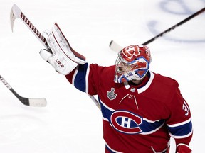 Montreal Canadiens goaltender Carey Price (31) points upwards his family, seated in the upper sections of the Bell Centre after beating Tampa Bay Lightning during the Stanley Cup finals, game 4, in Montreal on Monday, July 5, 2021.