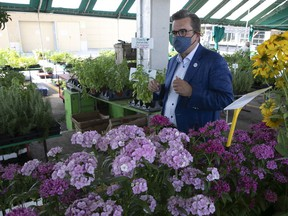 Montreal mayoral candidate Denis Coderre makes his way through the stalls of Jean-Talon Market on Thursday July 15, 2021. Coderre said a public market would also be a natural fit for Old Montreal's Marché Bonsecours.