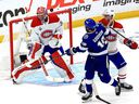 The Montreal Canadiens' Carey Price makes the save against Barclay Goodrow of the Tampa Bay Lightning during Game 5 of the 2021 NHL Stanley Cup Final.