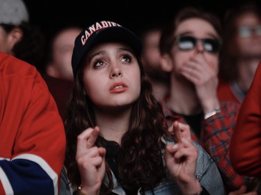 A Canadiens fan crosses her fingers hoping for a third-period comeback in Game 3 of the Stanley Cup Final at the Bell Centre in Montreal  on Friday, July 2, 2021.