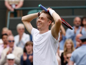 Canada's Denis Shapovalov celebrates his win over Russia's Karen Khachanov during their men's quarter-finals match on the ninth day of the 2021 Wimbledon Championships at The All England Tennis Club in Wimbledon, southwest London, on July 7, 2021.