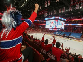 Montreal Canadiens hockey fans react as they watch the second away game of the Stanley Cup Finals, against Tampa Bay Lightning, at Bell Centre in Montreal, Quebec, Canada June 30, 2021.  REUTERS/Christinne Muschi