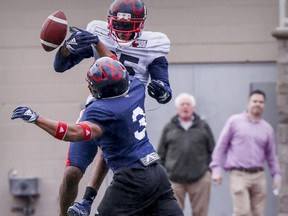 Linebacker Patrick Levels, 3, breaks up a pass intended for wide-receiver B.J. Cunningham during Alouettes practice in 2019.