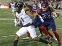 MONTREAL, QUE.: AUGUST 27, 2021 --  Montreal Alouettes Marc-Antoine Dequoy forces Hamilton Tiger Cats Frankie Williams out of bounds during Canadian Football League game in Montreal Friday August 27, 2021. (John Mahoney / MONTREAL GAZETTE) ORG XMIT: 66594 - 8238