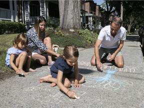Maya Angenot with her husband, Horia Bundaru, and their two daughters, five-year-old Éloïse, left, and seven-year-old Ariane. The kids make good use of the sidewalk in front of their N.D.G. home.