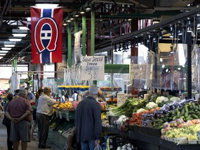 A Montreal Canadiens flag hangs from the rafters at Jean Talon Market in Montreal, on Monday, August 2, 2021.