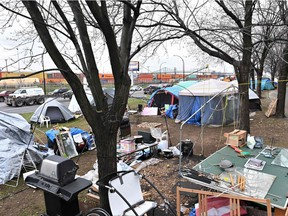 A homeless camp, set up in the summer of 2020, lines a busy Montreal boulevard in November 2020.