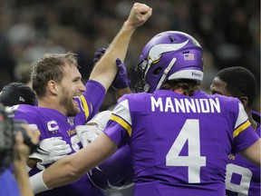 Minnesota Vikings quarterback Kirk Cousins (left) celebrates with teammates after defeating the New Orleans Saints in overtime of a NFC Wild Card playoff football game at the Mercedes-Benz Superdome in New Orleans on Jan. 5, 2020.