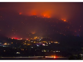 CP-Web. Flames are seen from the Christie Mountain wildfire along Skaha Lake near Penticton, B.C. Wednesday, August 19, 2020. Wildfires in the area have forced several thousand people to be on evacuation alert.