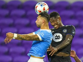 CF Montréal striker Romell Quioto, right, and New York City midfielder Valentin Castellanos vie for a header during the first half at Exploria Stadium in Orlando on July 7, 2021.