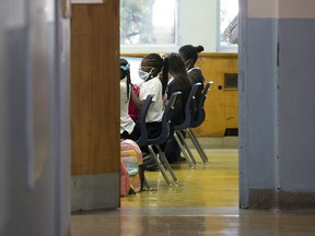 Parents have a lot to be worried about these days, Fariha Naqvi-Mohamed writes. Above: Kids attend class at St. Monica Elementary School in N.D.G.