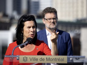 """Montreal Mayor Valérie Plante speaks as Gatineau Mayor Maxime Pedneaud-Jobin looks on at a press conference in Montreal on Tuesday, Sept. 7, 2021. Conservative Leader Erin O'Toole's pledge to review the classification of 1,500 types of military-style assault weapons is """"a step backwards,"""" Plante says."""