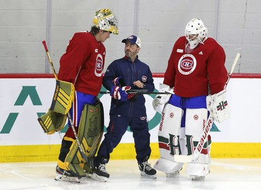 """Laval Rocket goalie coach Marco Marciano looks up at 6'6"""" goalie Joe Vrbetic as Alexis Gravel listens on the first day of Montreal Canadiens' rookie camp at the Bell Sports Complex in Brossard on Thursday, September 16, 2021."""