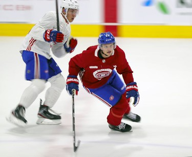 Mattias Norlinder, right, cuts in front of Gianni Fairbrother during first day of Montreal Canadiens' rookie camp at the Bell Sports Complex in Brossard on Thursday, Sept. 16, 2021.