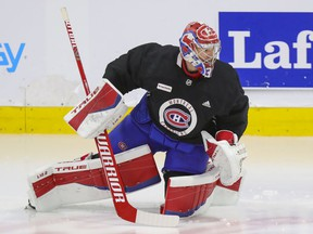 Canadiens goaltender Carey Price does some exercises on the ice under the supervision of a member of the team's training staff at the Bell Sports Complex in Brossard on Thursday.