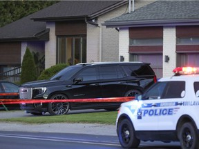 Crime scene tape around a home on Lévesque Blvd. in Laval, north of Montreal Tuesday Sept. 21, 2021. The owner of the home, Davide Barberio, was shot and wounded outside his house Tuesday afternoon.