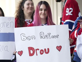 A Canadiens fan expresses support to Jonathan Drouin outside the parking garage as the Montreal Canadiens arrive for the Red vs. White scrimmage on Sunday, Sept. 26, 2021.