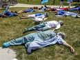 """Health care workers held a """"die-in"""" at Maisonneuve-Rosemont Hospital on May 27, 2020 to highlight the exhaustion and burnout of those working in the network."""