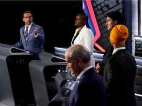 From left: Bloc Québécois Leader Yves-François Blanchet, Green Party Leader Annamie Paul, Liberal Leader Justin Trudeau, NDP Leader Jagmeet Singh and Conservative Leader Erin O'Toole take part in the English-language debate in Gatineau on Sept. 9, 2021.