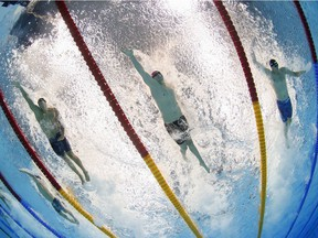 For the Tokyo Olympics, Speedo introduced an innovative suit constructed of three layers of different fabrics, the identity of which are propriety information. From left: Caeleb Dressel (U.S.), Kliment Kolesnikov (Russian Olympic Committee) and Alessandro Miressi (Italy) compete in the men's 100-metre freestyle final.