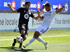 CF Montréal midfielder Mathieu Choiniere (29) and Chicago Fire FC defender Miguel Angel Navarro (6) battle for the ball during the first half at Saputo Stadium on Sunday, Sept. 19, 2021.