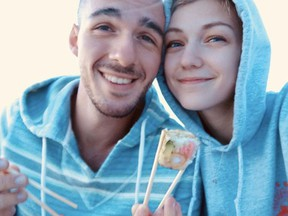 Gabrielle Petito, 22, who was reported missing on September 11, 2021 after traveling with her boyfriend around the country in a van and never returned home, poses for a photo with Brian Laundrie in this undated handout photo.  North Port/Florida Police/Handout via REUTERS  THIS IMAGE HAS BEEN SUPPLIED BY A THIRD PARTY.