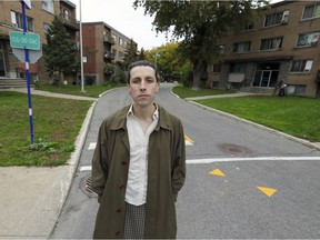 Duncan McLachlan, standing outside some apartment buildings in Pointe-Claire, is the TQSOI project coordinator for a West Island tenants' rights association.