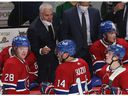 Montreal Canadiens coach Dominique Ducharme talks to his players during a timeout in overtime  in NHL action in Montreal on Thursday October 07, 2021.