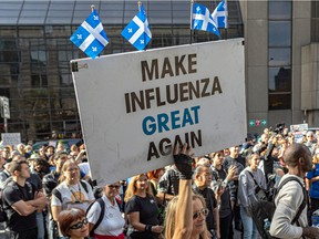 Montrealers protested against vaccine mandates in Montreal on Saturday, Oct. 9, 2021, as a court challenge is going to be filed to temporarily halt the province's suspension without pay of all non-vaccinated health-care workers.