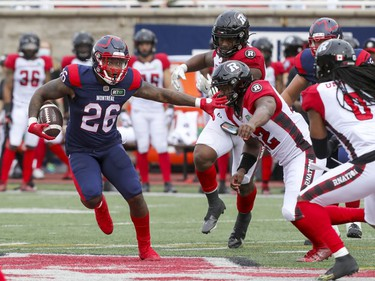 Montreal Alouettes running back Cameron Artis-Payne runs with the football against the Ottawa Redblacks defence during Canadian Football League game in Montreal Monday October 11, 2021.