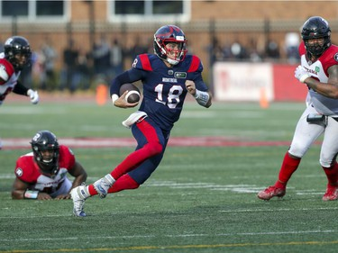 Montreal Alouettes quarterback Marrhew Shiltz runs for a first down during game-winning drive against the Ottawa Redblacks in Canadian Football League game in Montreal Monday October 11, 2021.