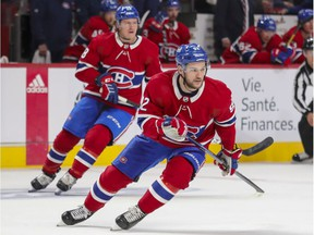 Montreal Canadiens' Jonathan Drouin and Christian Dvorak, rear, change directions during first period against the San Jose Sharks in Montreal on Oct. 19, 2021.
