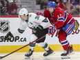 Montreal Canadiens' Josh Anderson leans on San Jose Sharks' Mario Ferraro during third period in Montreal on Oct. 19, 2021.