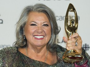 Ginette Reno holds up her award at the Gala Adisq awards ceremony in Montreal on Oct. 27, 2019.