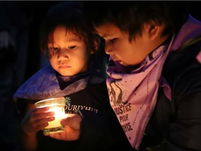 """Siblings Stéphanie (left) and Maiden Dubé attend a Montreal vigil on the first anniversary of the death of their aunt Joyce Echaquan. On systemic racism, Premier François Legault """"always turns the question inside out,"""" Tom Mulcair writes."""
