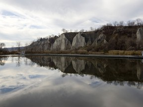 A view of the Scarborough Bluffs reflected in a pond at Bluffers Park in Scarborough, Ontario.
