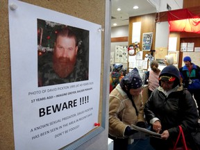 A 2012 poster in the Vancouver Area Network of Drug Users office warns Downtown Eastside residents about the brother of serial killer Robert Pickton. The poster alleges that David Pickton is a sexual predator and that he has been seen in the area.