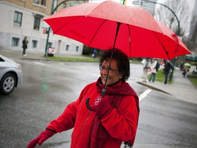 Dr. Hedy Fry, Liberal MP for Vancouver Centre, waves to cars in downtown Vancouver, British Columbia in a file photo.