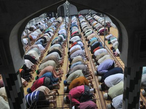 Pakistani Muslims offer Friday prayers at a mosque during the month of Ramadan in Lahore on July 26, 2013.