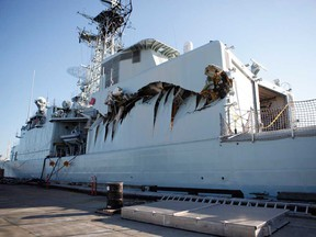 Royal Canadian Navy warship HMCS Algonquin sits in port with significant damage to her port side hangar at CFB Esquimalt in Esquimalt, B.C. Sunday September 1, 2013 following a collision with the HMCS Protecteur during a close-quarters training exercise.