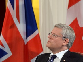 Prime Minister Stephen Haper takes part in an economic question and answer session at Mansion House in London, England on Wednesday Sept. 3, 2014.