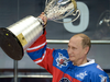 Russian President Vladimir Putin brandishes the trophy  after a hockey match between former NHL stars and officials at the Shayba Arena in the Black Sea resort of Sochi, Russia.