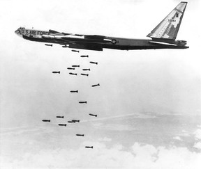 A U.S. Air Force strategic air command B-52 stratofortress drops a string of 750-pound bombs over a coastal target in the Republic of Vietnam during the Vietnam War, Oct. 1965.